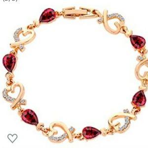 New! Stunning gold bracelet w ruby red heart diamo